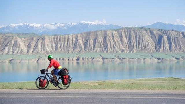 Pedaling past Lake Toktogul, Kyrgyzstan.