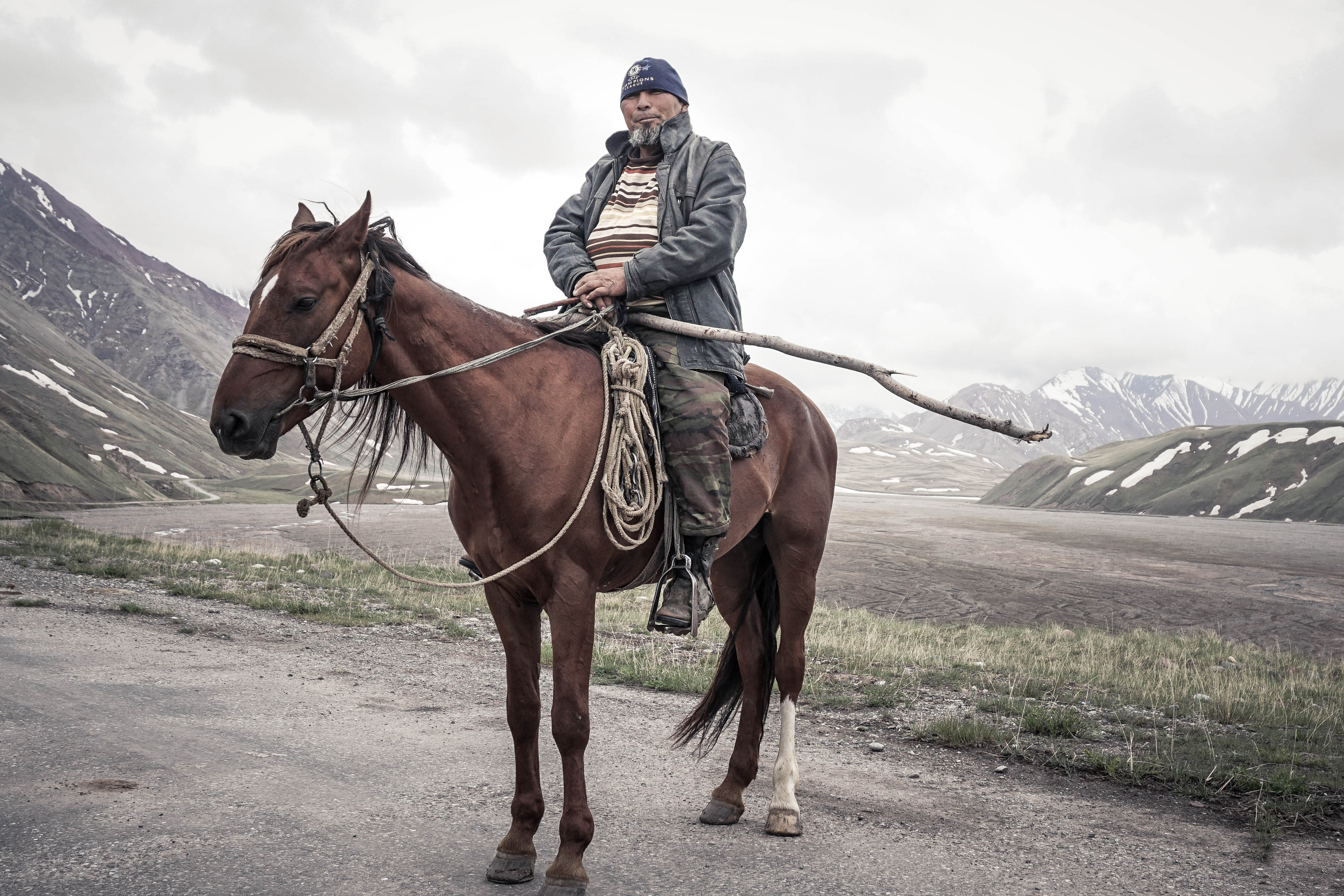 A proud Pamiri man on horseback stops to chat.