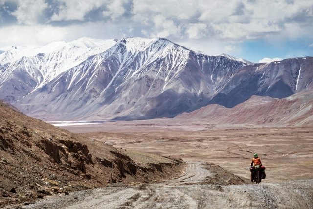 Tackling a rough section of the remote Pamir Highway.