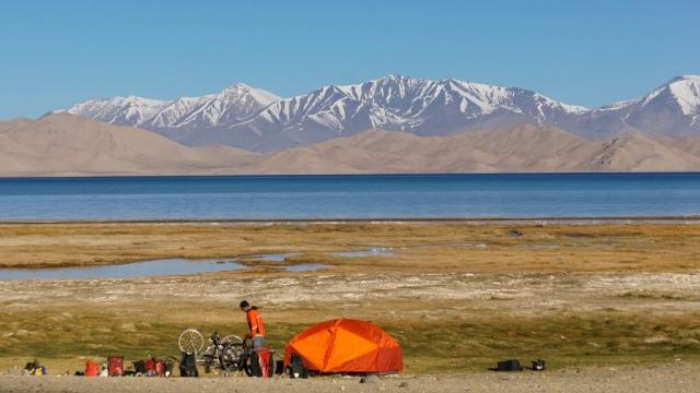 Camping on the shores of Lake Karakul, Tajikistan.