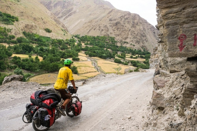 A narrow section of the Pamir Highway with stunning views of Afghanistan just a stone's throw away.