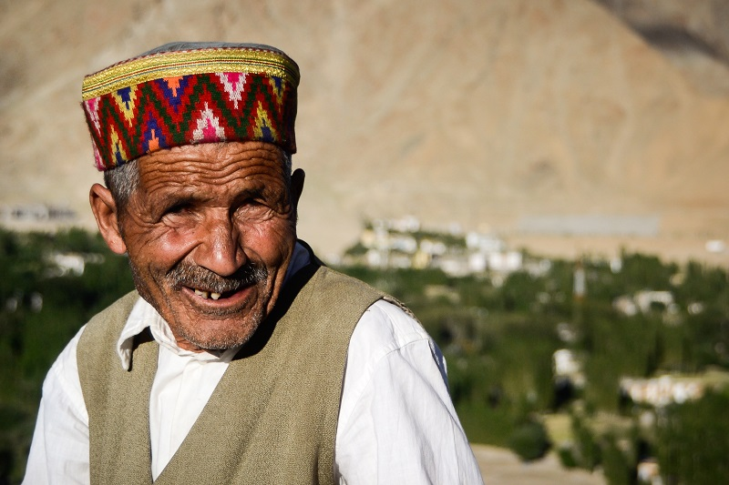 Man sporting traditional hat in northern India.