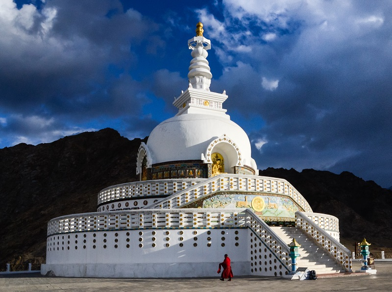 A devoted monk makes his morning rounds at Shanti Stupa in Leh, Ladakh, northern India.